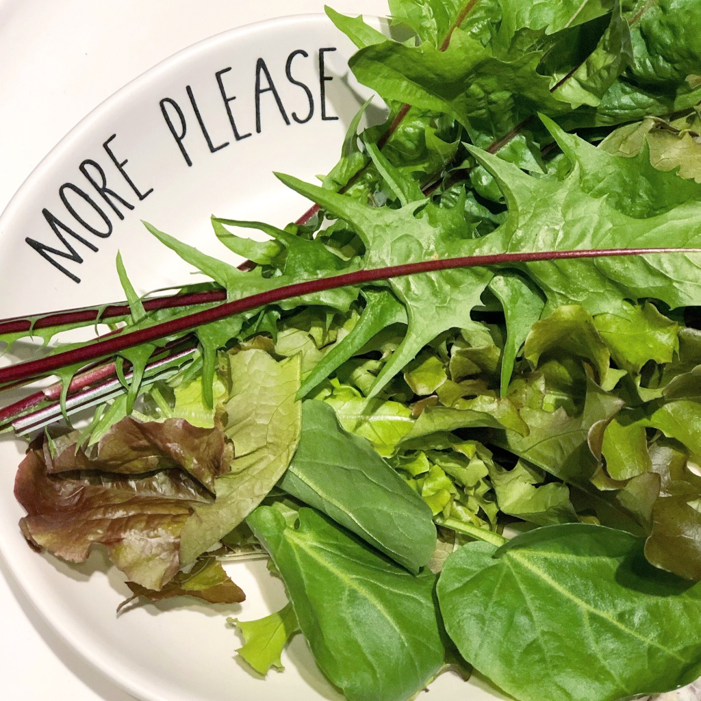 Plate of greens with dandelion
